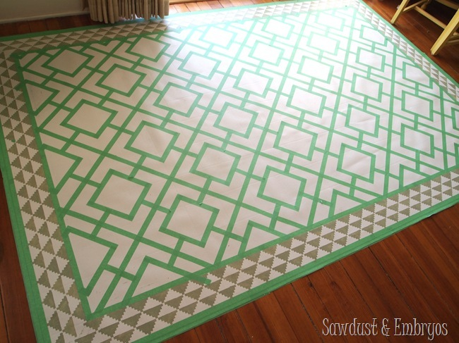 Paint a remnant of linoleum to look like a legit area rug for under your dining table!
